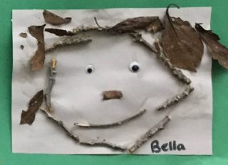 Face picture made from sticks and leaves art project