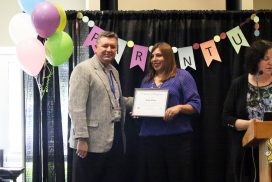 Parent U graduate receiving certificate